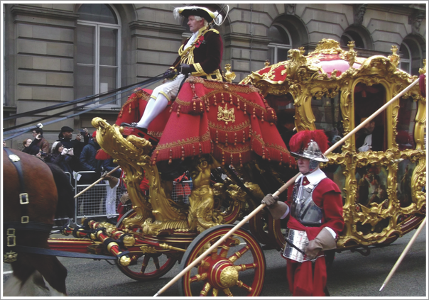 The Lord Mayor's Coach during the annual Lord Mayor's Show. The Lord Mayor's Coachman sits atop the coach which is in turn escorted by a Pikeman of the Honourable Artillery Company's Pikemen and Musketeers